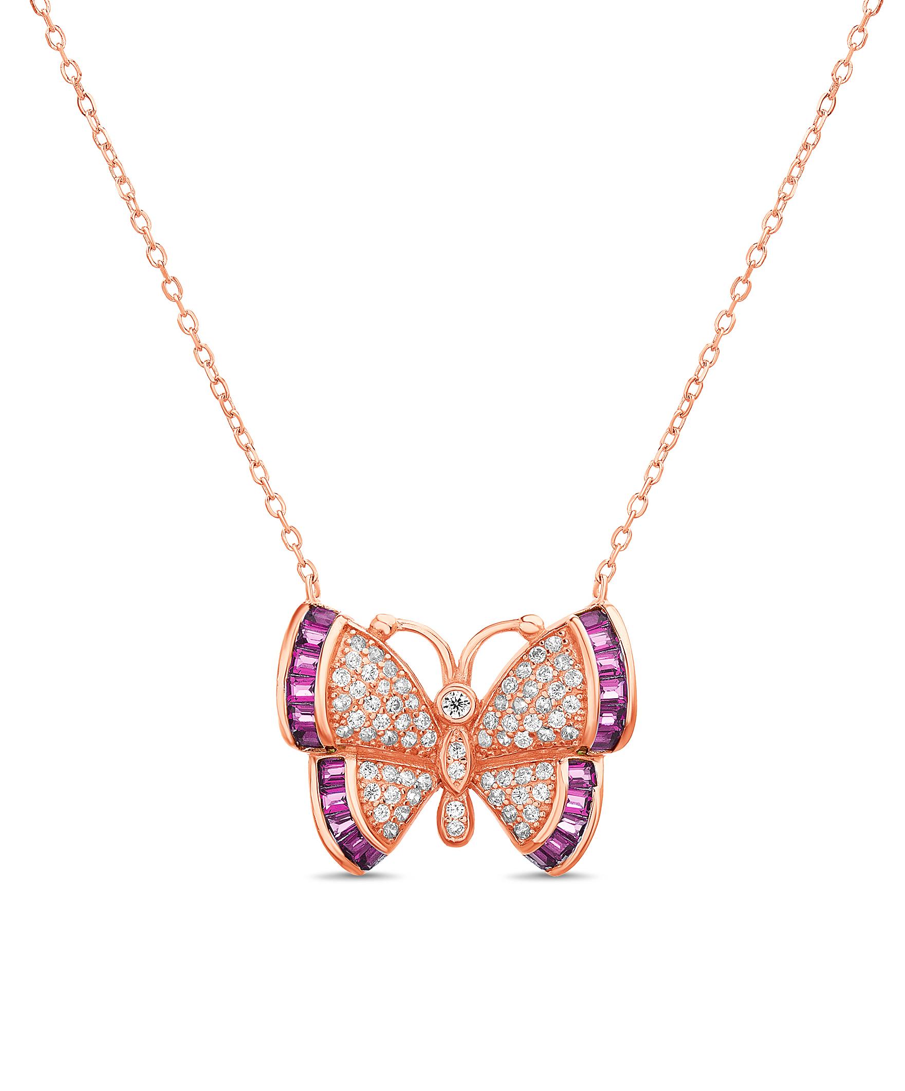 Conjunto rosado,mariposa, piedras blancas, baguettes rosadas