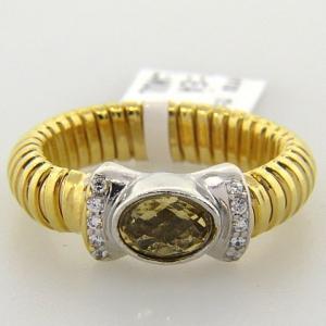 anillo resorte simple con cubic central  champang  y pave enchapado amarillo
